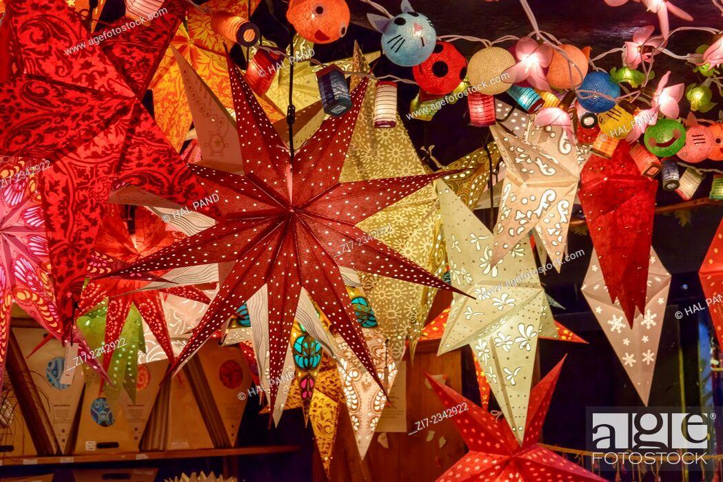 Stock Photo: detail of lightened stars in stall at traditional Christmas market hold in city center, Stuttgart, Germany.