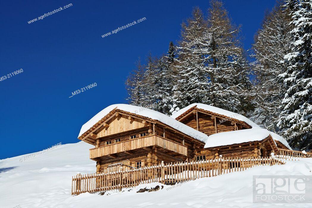 Stock Photo: A wooden chalet during winter. sesto Municipality. Bolzano Province. Trentino-Alto Adige. Italy.