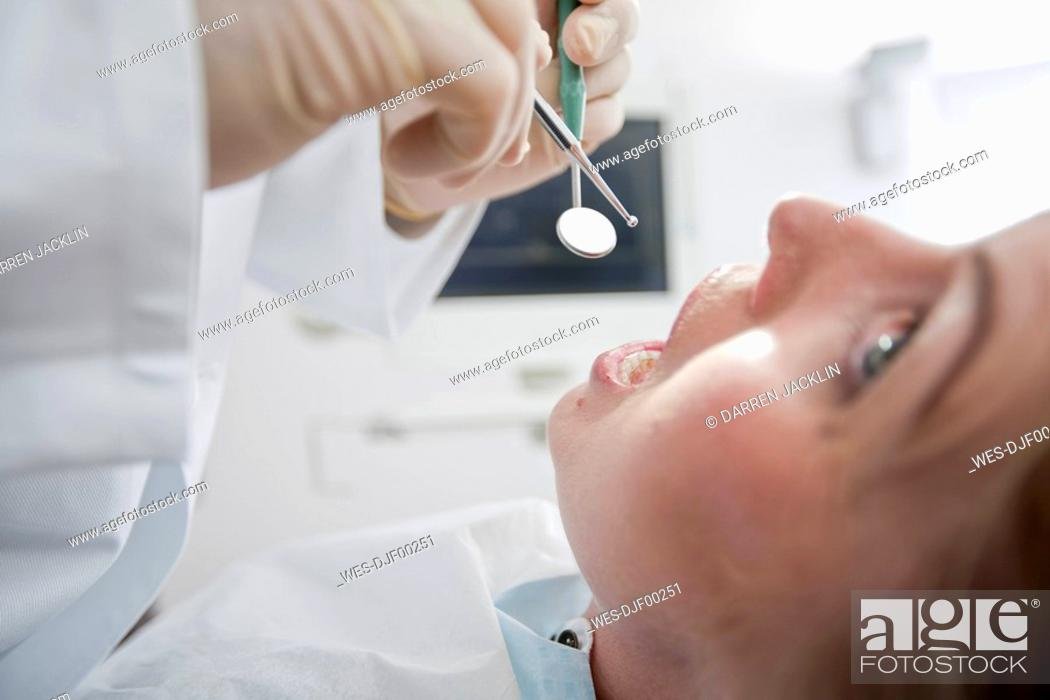 Stock Photo: Germany, Bavaria, Landsberg, Woman in dental surgery, portrait.