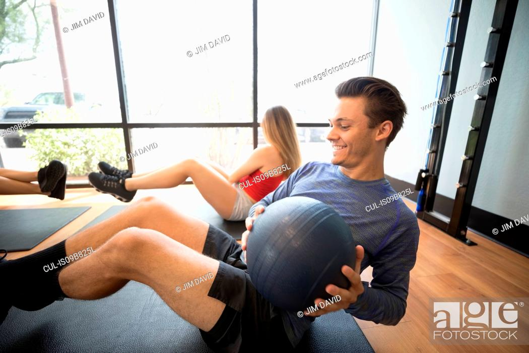 Stock Photo: Friends training with medicine ball in gym.