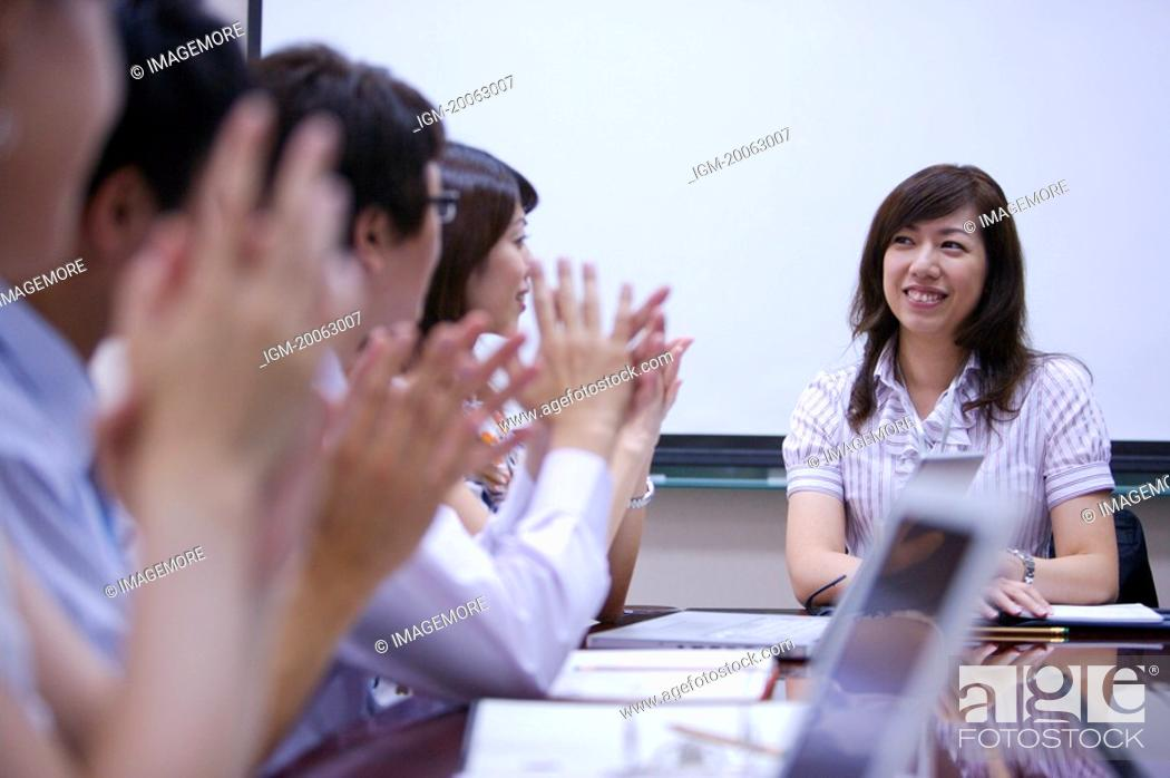 Stock Photo: People clapping for success together.