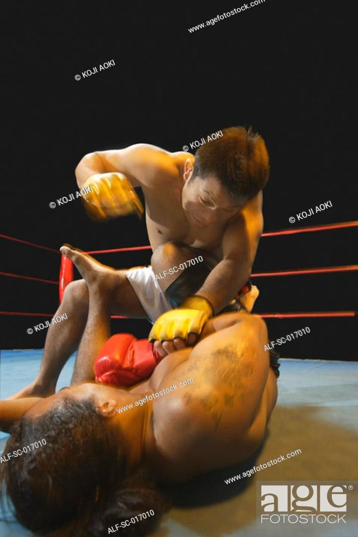 Stock Photo: Mixed Martial Arts Fighter Punching.