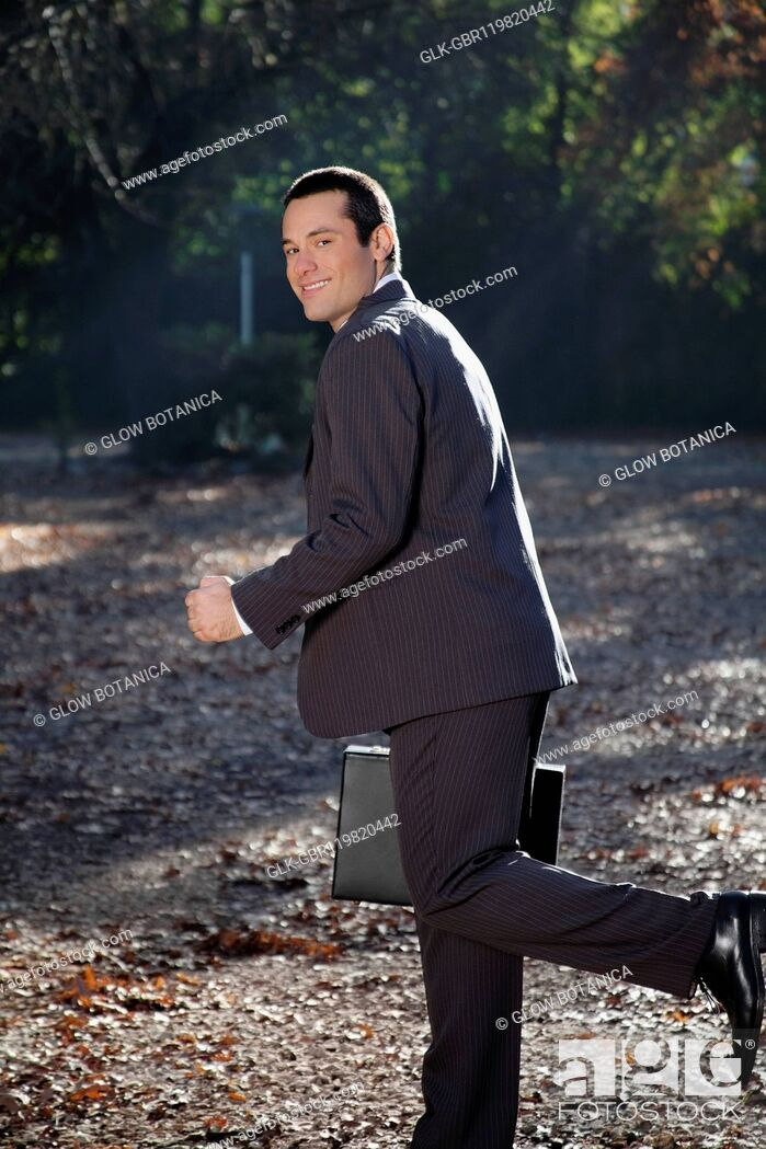 Stock Photo: Businessman running in a park.