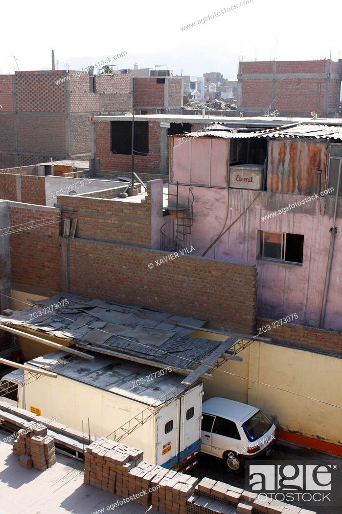 Stock Photo: Houses in the popular district of San Martin de Porras, Lima, capital of Peru.