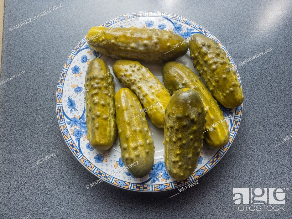 Stock Photo: Pickled cucumber is a cucumber that has been pickled in a brine, vinegar, or other solution and left to ferment for a period of time.