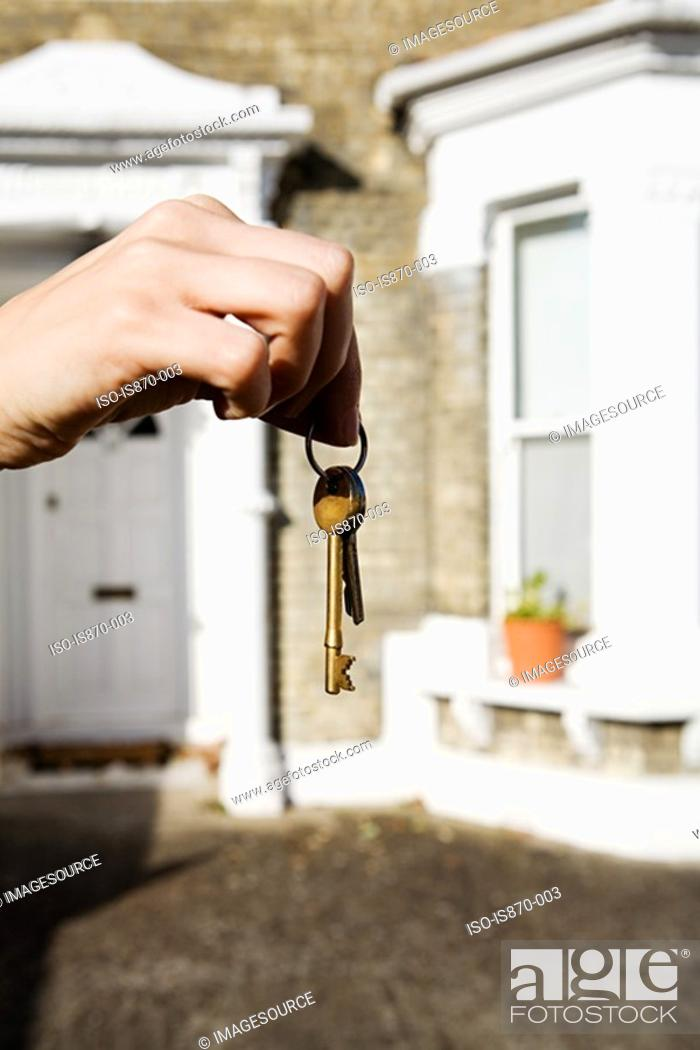 Stock Photo: Person with keys to house.
