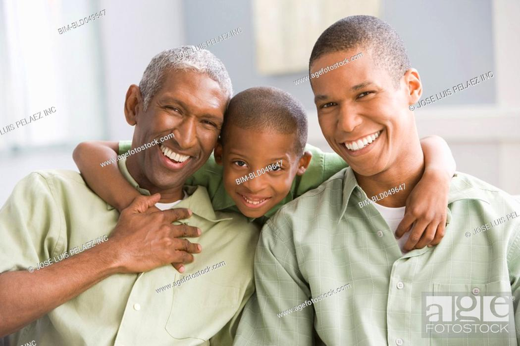 Stock Photo: African American grandfather, father and son hugging.