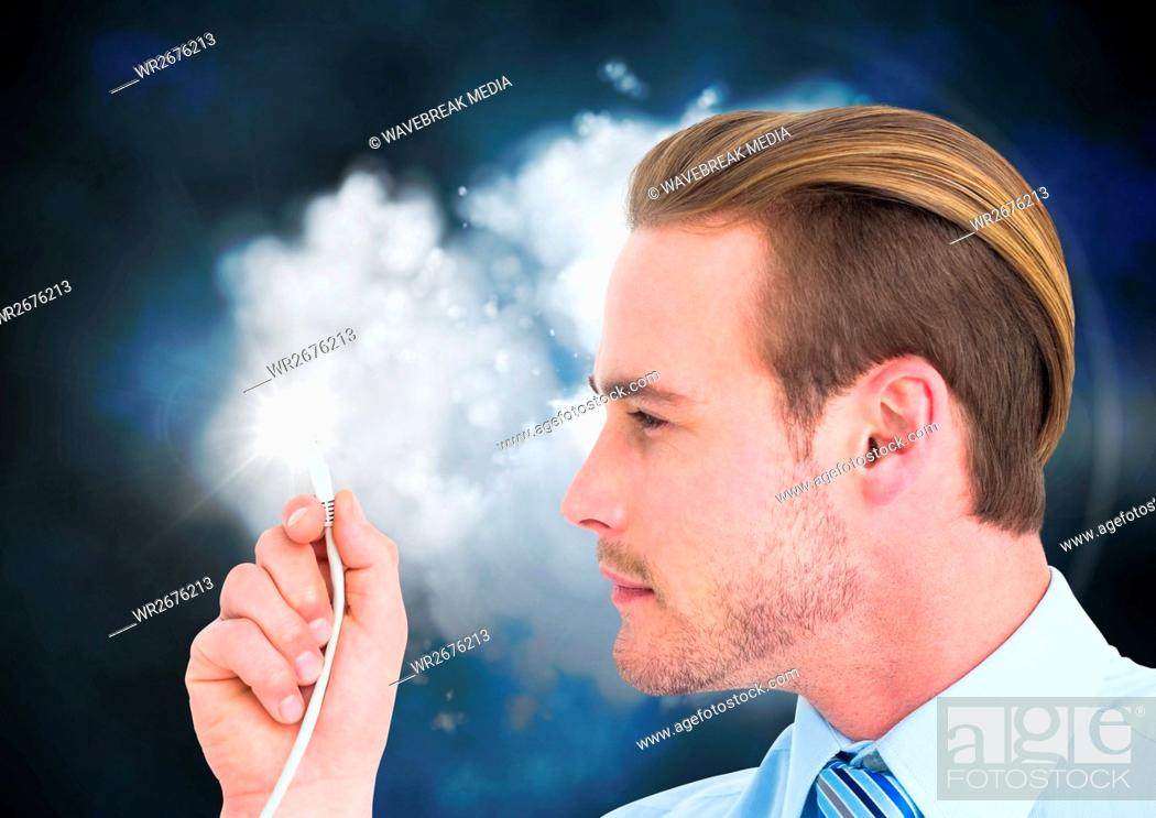 Stock Photo: Businessman looking at cable with flare.