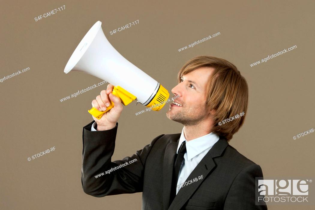 Stock Photo: Businessman holding megaphone.