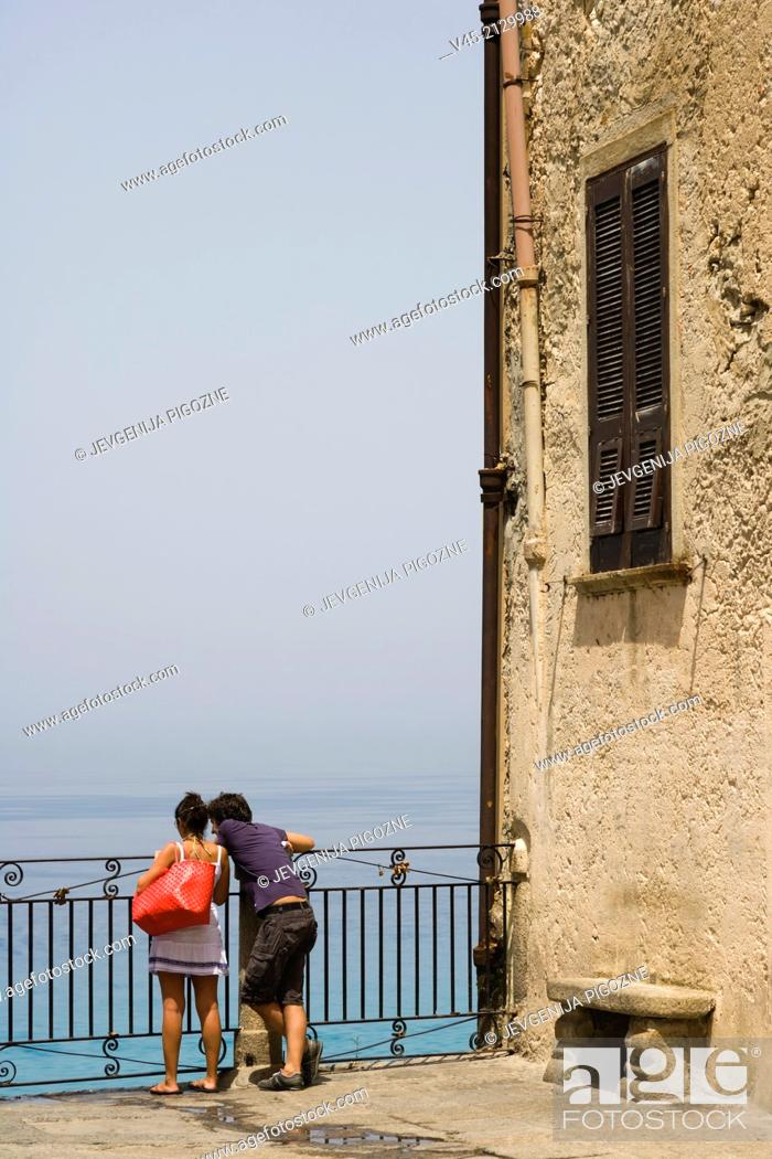 Stock Photo: A couple enjoying the view from the terrace of Corso Vittorio Emmanuele, Tropea, Vibo Valentia, Calabria, Southern Italy, Italy.