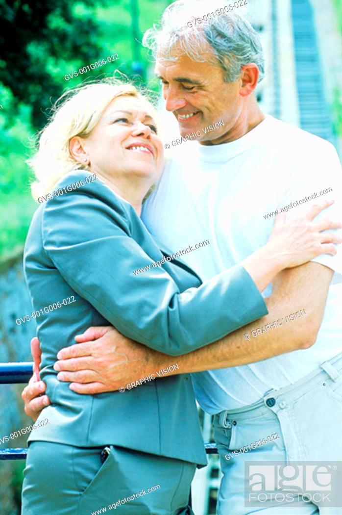 Stock Photo: Mature couple hugging in a garden.