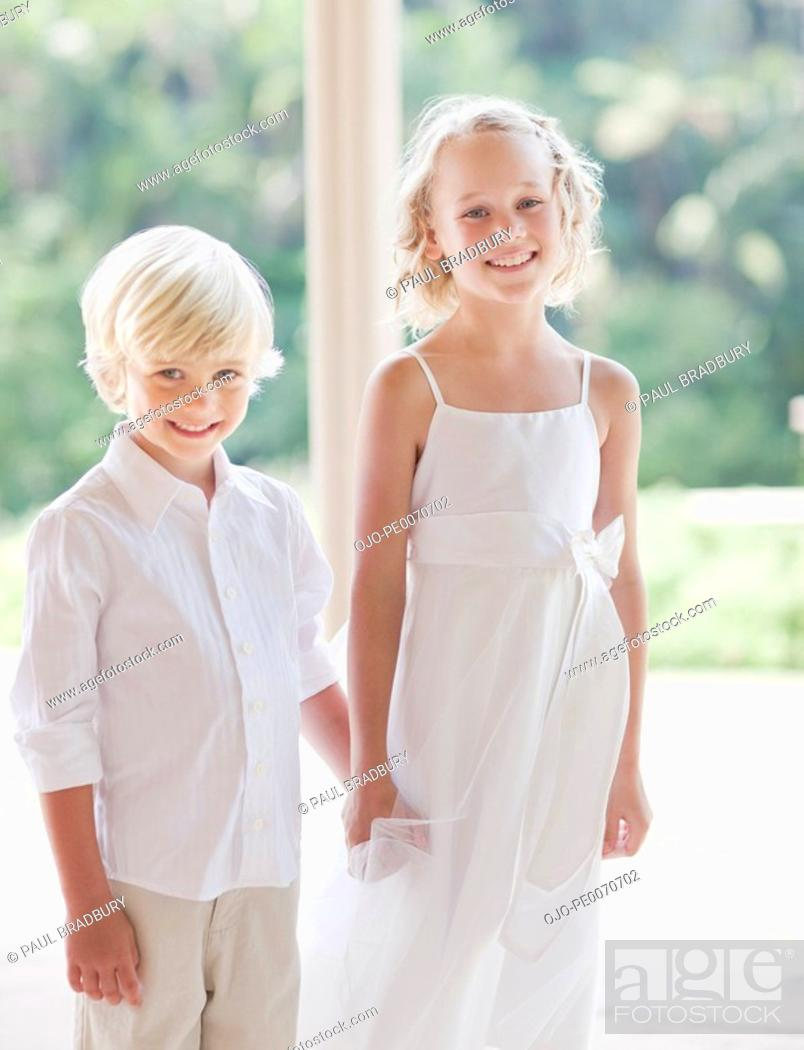 Stock Photo: Flower girl and boy at wedding reception.