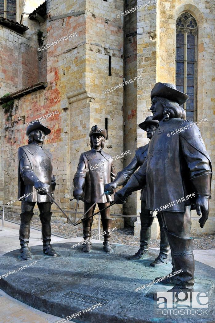 Stock Photo: Statue of d'Artagnan and The Three Musketeers at Condom, Pyrenees, France.