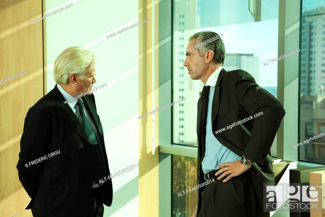 Stock Photo: Executives having private conversation.