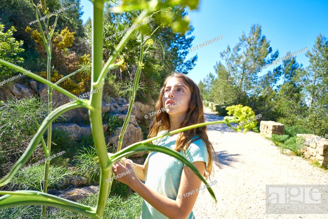 Imagen: Brunette teen girl in Mediterranean track with fennel plants.