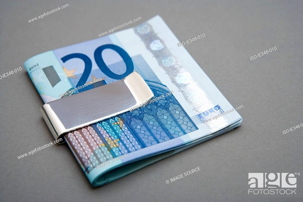 Stock Photo: Twenty euro notes in money clip.