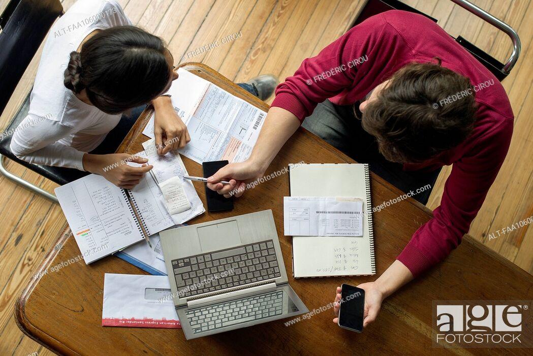 Stock Photo: Couple manage family finances together.