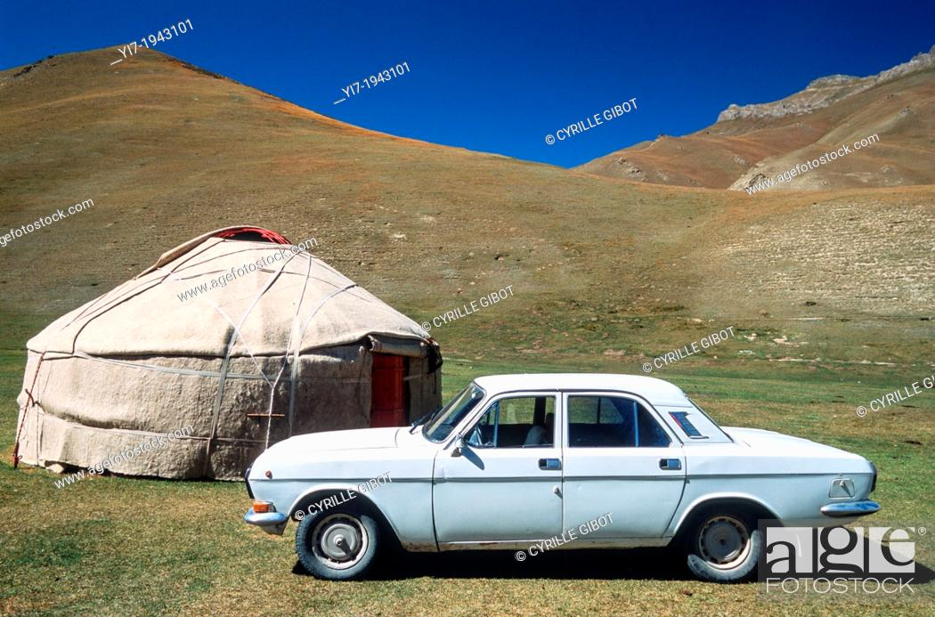 Stock Photo: Old Russian car next to a yurt, Tash Rabat, Kyrgyzstan, Central Asia.