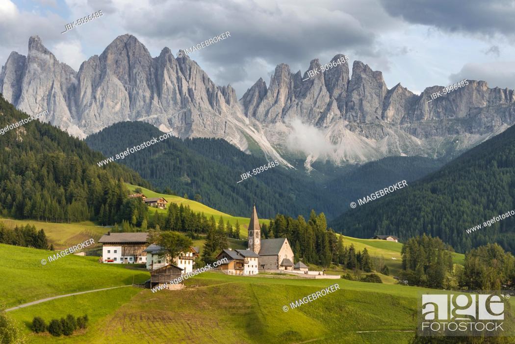 Stock Photo: Church St. Magdalena, Villnößtal, in the back Geislergruppe with Sass Rigais, St. Magdalena, Bolzano, South Tyrol, Italy, Europe.