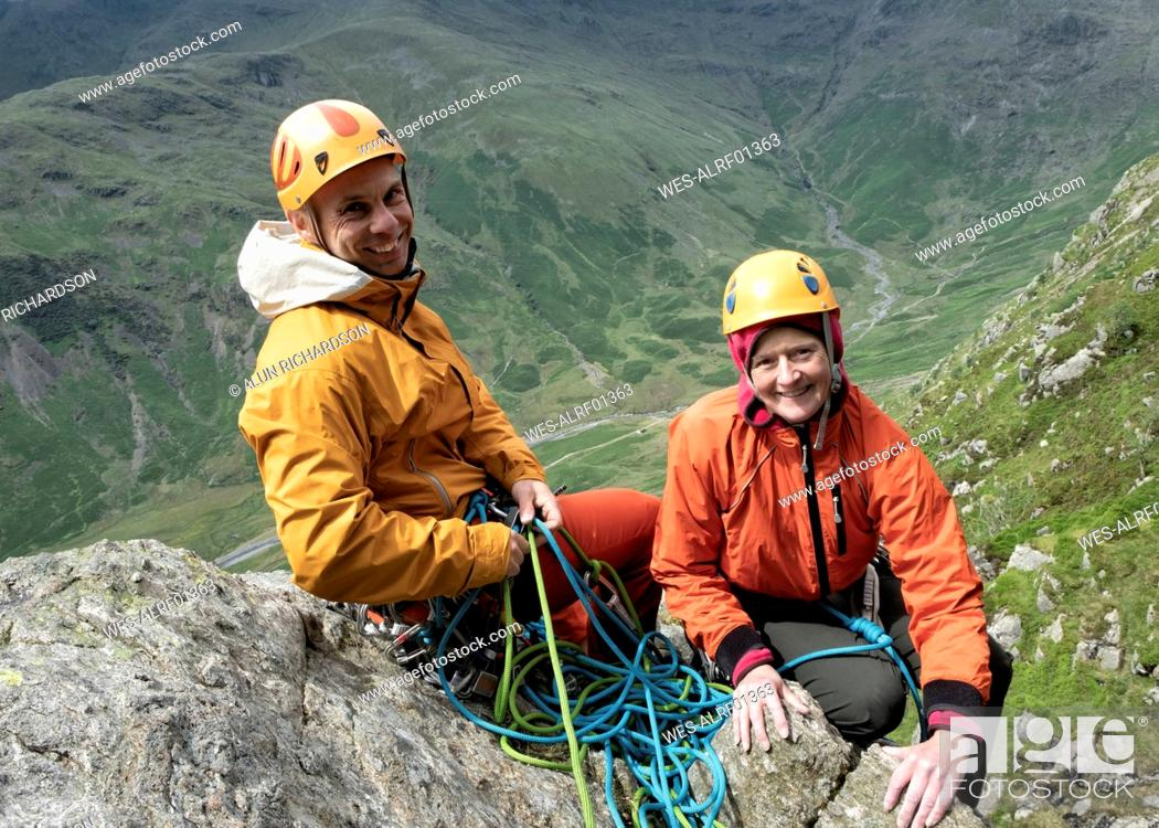 Stock Photo: England, Langdale Valley, Gimmer Crag, climbers, couple.