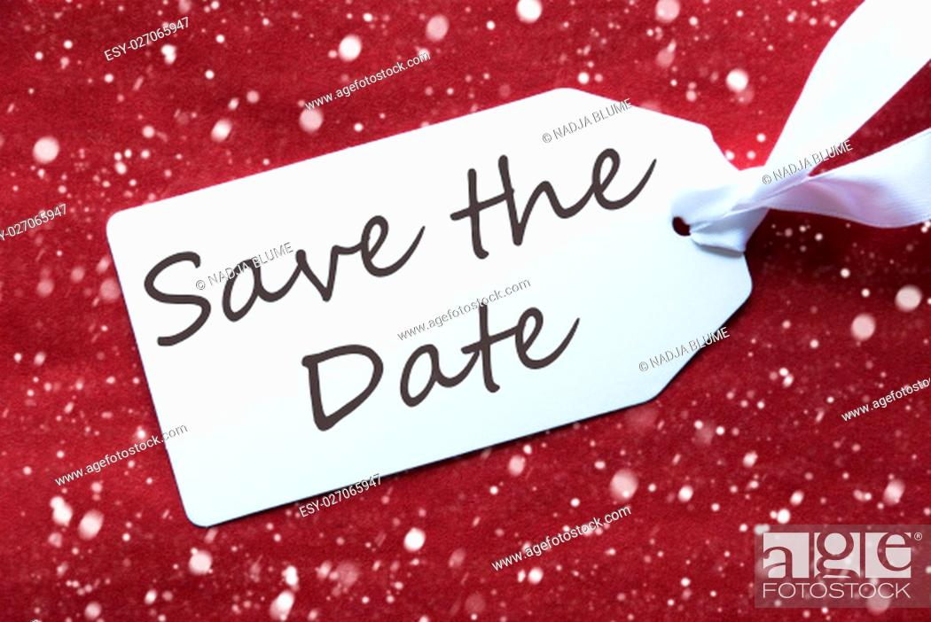 Stock Photo: English Text Save The Date. One White Label On A Red Textured Background. Tag With Ribbon And Snowflakes.