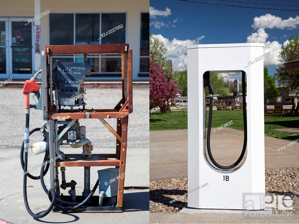 Stock Photo: Lusk, Wyoming - A stripped gasoline pump (left) at a closed general store. A block away is a Tesla Supercharger in the parking lot of a motel.