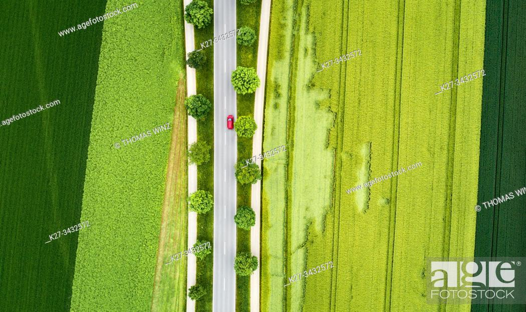 Stock Photo: Highway through agricultural fields in springtime from above, near Stuttgart, Germany.