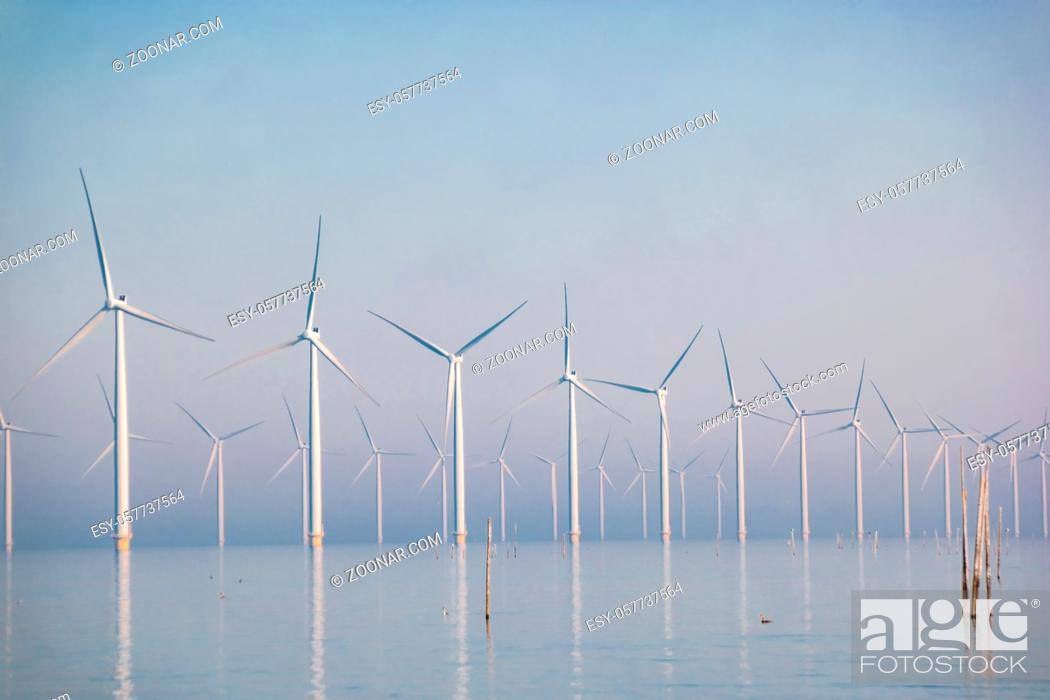 Stock Photo: offshore windmill park with clouds and a blue sky, windmill park in the ocean drone aerial view with wind turbine Flevoland Netherlands Ijsselmeer.