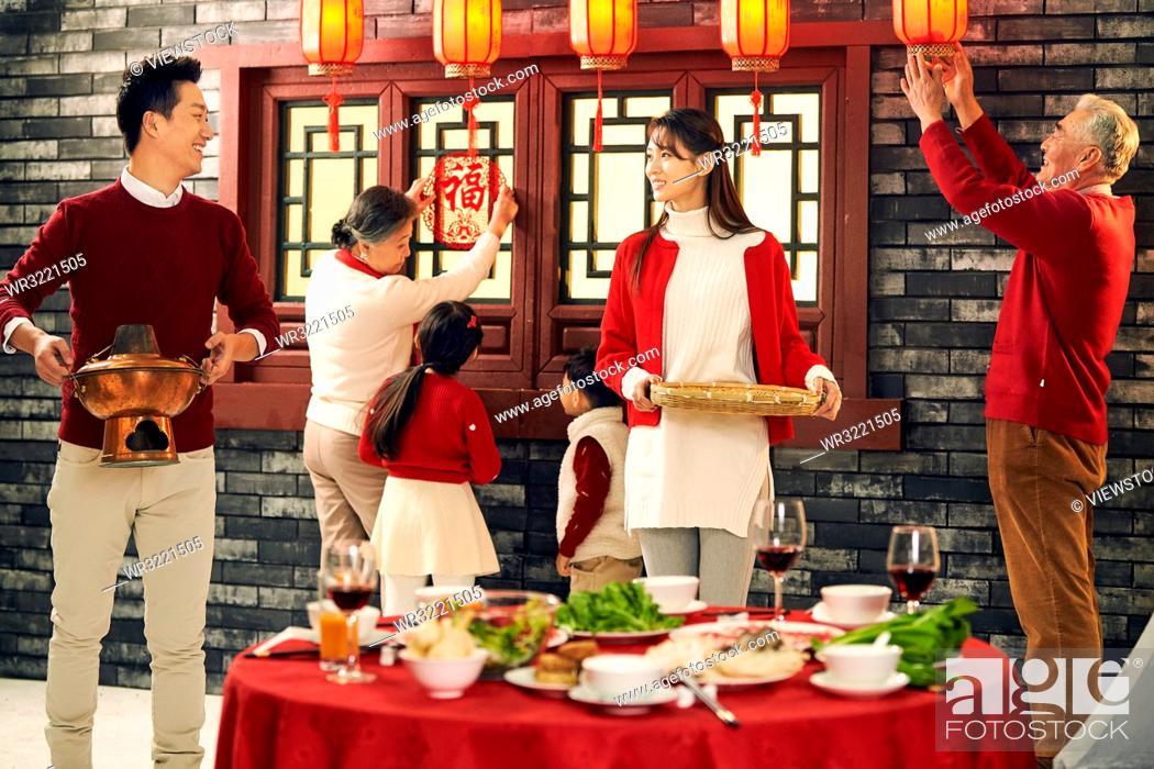 Stock Photo: Happy family for dinner.