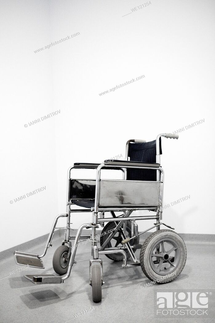 Stock Photo: Empty wheel chair in a hospital.