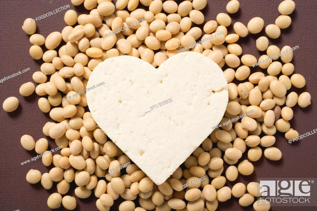 Stock Photo: Tofu heart on soya beans.
