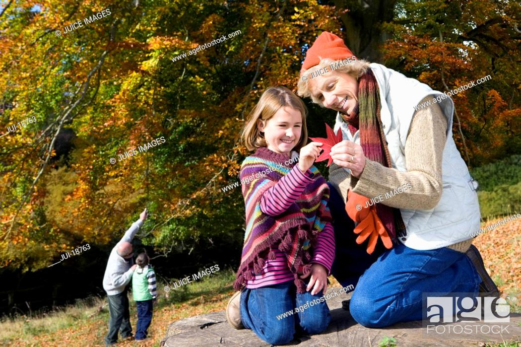 Stock Photo: Grandparents and grandkids exploring in woods.