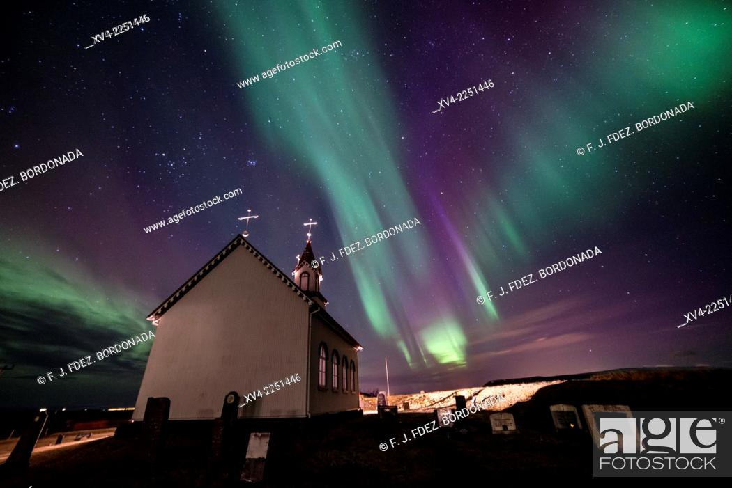 Stock Photo: Winter Icelandic landscape with Northern lights background. Iceland.