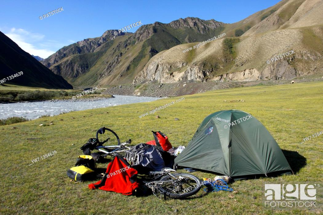 Stock Photo: A tent and two bicycles in   , Kyrgyzstan.