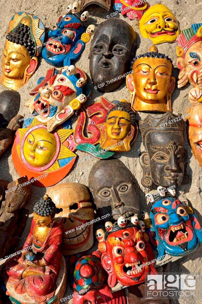 Masks, pottery,souvenirs, hanging in front of the shop