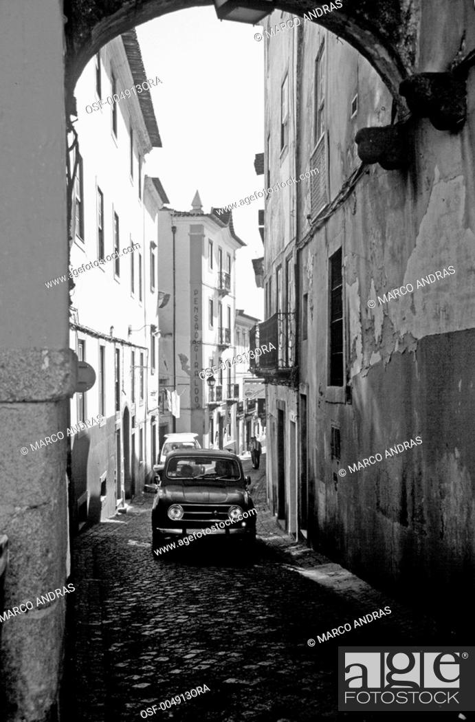Stock Photo: portugal one car driving in a narrow street alley.
