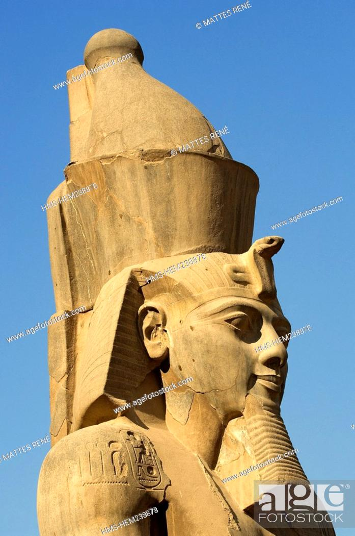 Stock Photo: Egypt, Upper Egypt, Nile Valley, Luxor Temple listed as World Heritage by UNESCO, detail of Ramses II's head in front of the entrance of the 2nd pylon.
