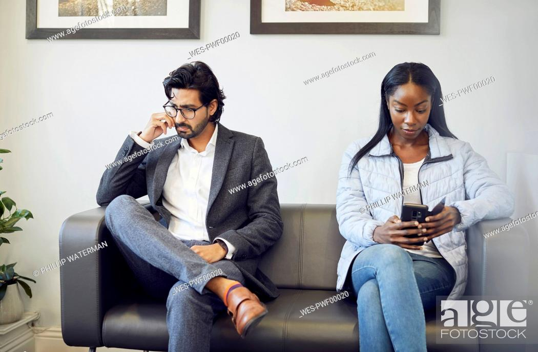 Stock Photo: Two patients in waiting room of a medical practice.