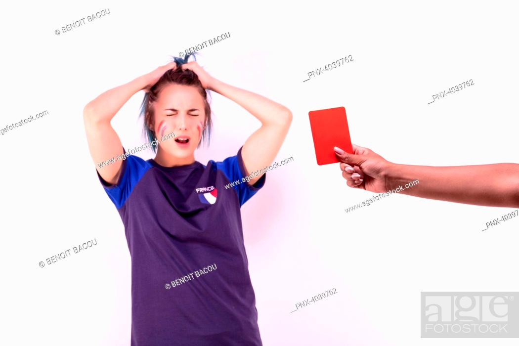 Stock Photo: Portrait of a young supporter of the French football team facing a red card.