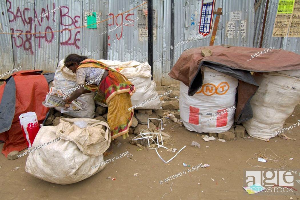 Stock Photo: an homeless poor woman collect papaer from street rubbish. sakinaka district. mumbay. maharashtra. india. asia.