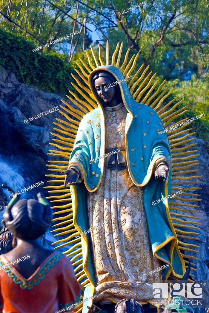 Stock Photo: Low angle view of a statue of Virgin Mary, Virgin of Guadalupe, Tepeyac, Mexico city, Mexico.