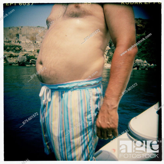 Stock Photo: Fat stomach of a young man.