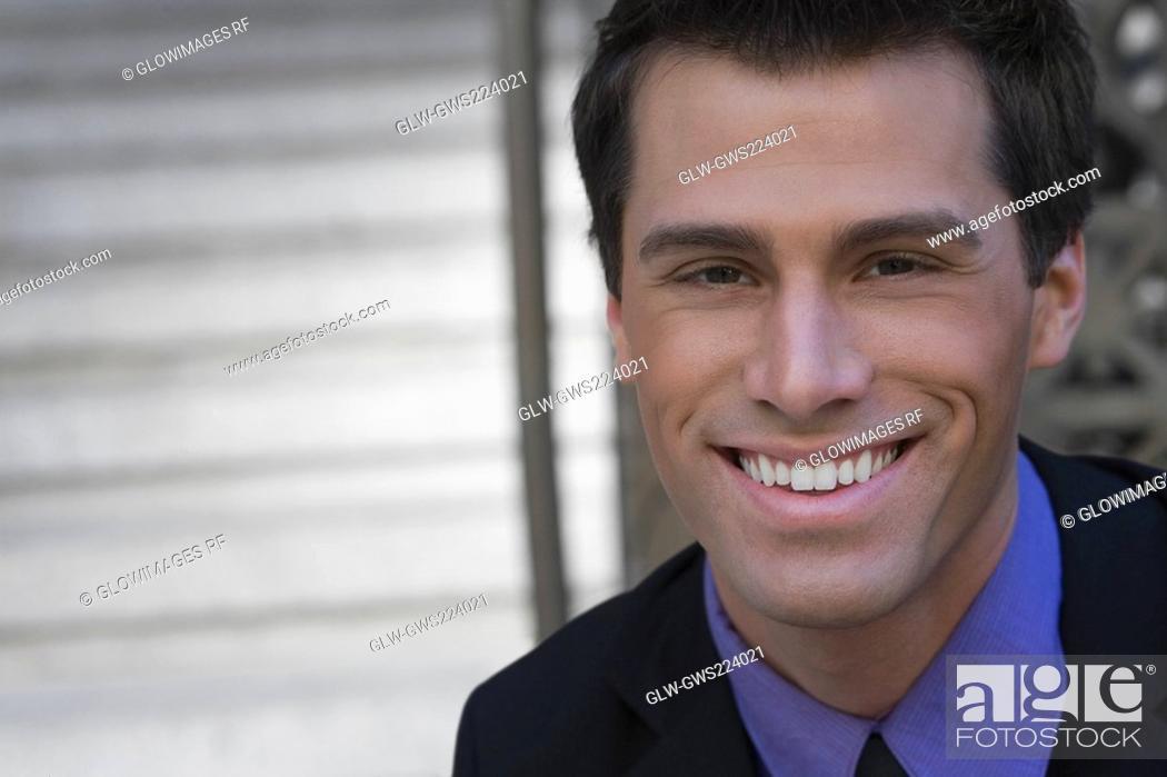 Stock Photo: Portrait of a businessman smiling.