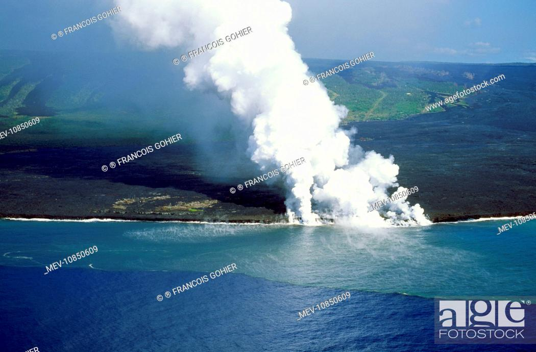 Stock Photo: Volcano - Larva flowing from Kilauea and entering the sea. Hawaii - USA.