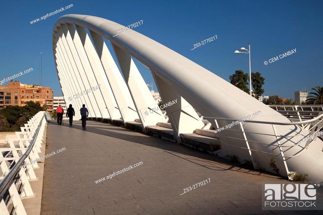 Stock Photo: People walking on the Pont de L'Exposicion'La Peineta' or 'Alameda Bridge' by Santiago Calatrava, in Jardi del Turia gardens, Valencia, Spain, Europe.
