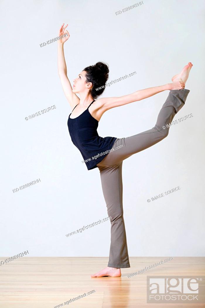 Stock Photo: Woman practicing yoga.