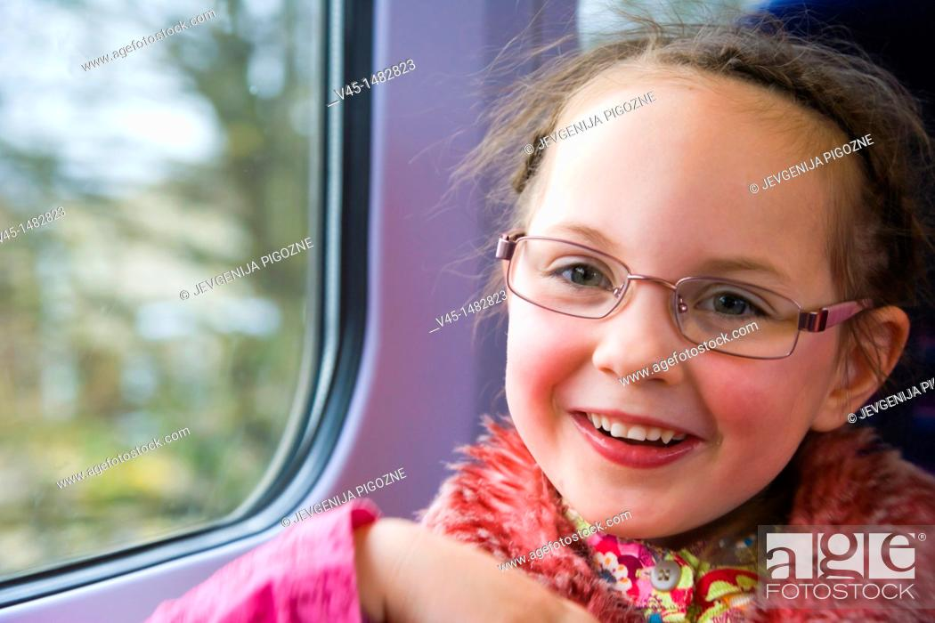 Stock Photo: Happy 5 years old girl in the train.