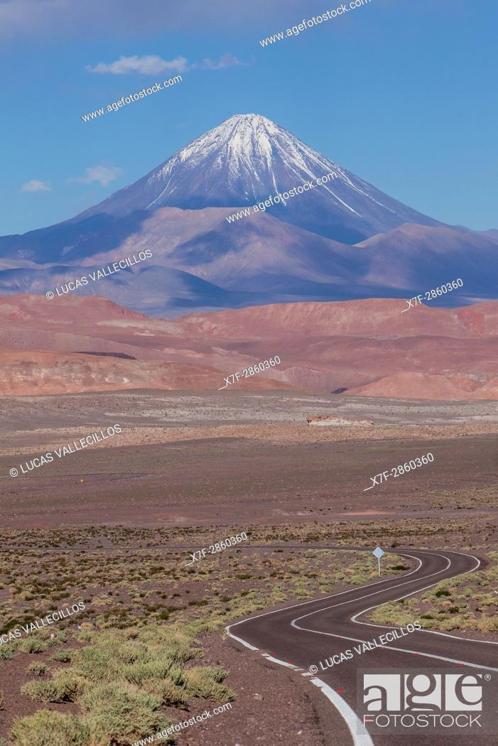 Stock Photo: Road to Valle del Arcoiris (Rainbow Valley), in background Licancabur volcano, Atacama desert. Region de Antofagasta. Chile.