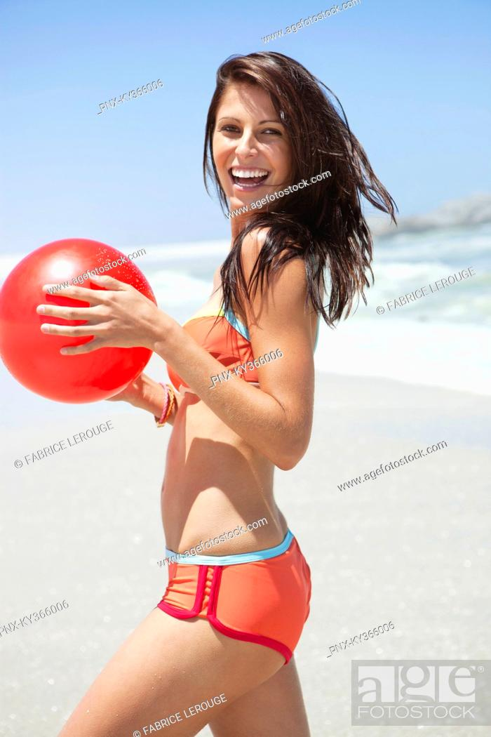 Stock Photo: Portrait of a woman playing with beach ball.