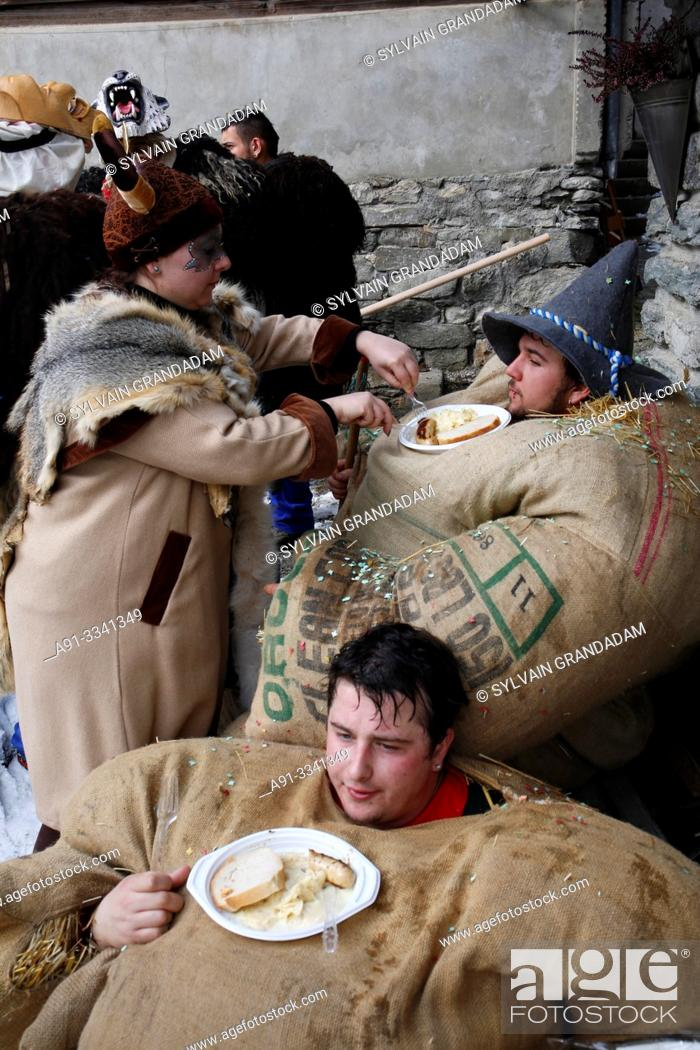 "Stock Photo: Switzerland, Valais, Val d'Herens, village of Evolene, Carnaval, preparation of the ""empailles"" ( young men dressed with old bags stuffed with about 50 kgs of."